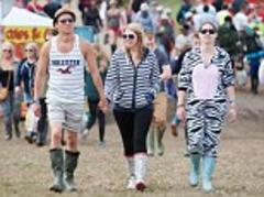 Wellies on for start of Isle of Wight Festival as weekend rain threatens to turn it in to Glastonbury-style mudbath